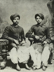 Gandhi (right) with his eldest brother Laxmidas in 1886.[40]