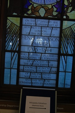 Window at ICE headquarters commemorating its founding