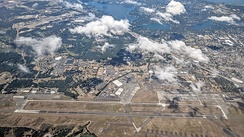 Aerial view of McChord Field from the east, with the rest of Joint Base Lewis–McChord in the left background, and the city of Lakewood in the right background