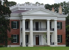 Greek Revival facade of Melrose plantation house, Mississippi.
