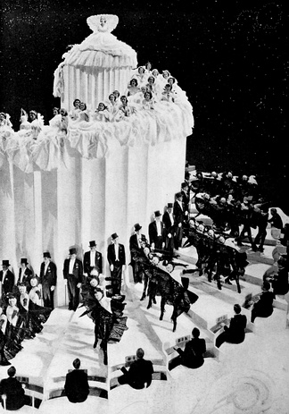 "The extravagant ""Wedding Cake"" sequence featured a towering rotating volute of 70 ft diameter with 175 spiral steps, weighing 100 tons. This number, ""A Pretty Girl is Like a Melody"", won the Academy Award for Best Dance Direction for 1936."