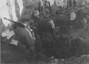 NARA copy #20, IPN copy #19A bunker being openedStroop witnesses digging out of a bunker, possibly near the ghetto wall. 8 May 1943