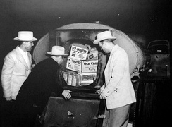 Photo of Texas Liquor Control Board agents viewing a stash of illegal alcohol.