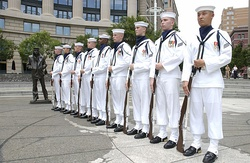 U.S. Navy ceremonial guard wearing white canvas leggings as part of the U.S. Navy's enlisted full dress whites.