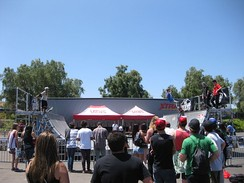 Athletes perform exhibitions of skateboarding, BMX biking, and other sports on half-pipes and other ramps during the tour. Attendees are often also permitted to participate.