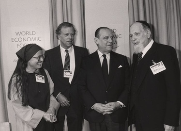 Raymond Barre standing next to Mother Tessa Bielecki and Rabbi Immanuel Jakobovits during the 1989 World Economic Forum