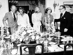 Vice President Rockefeller (right) and his wife Happy (second on left) entertain President Gerald R. Ford (left) his wife Betty (second on right) and their daughter Susan (center) at Number One Observatory Circle on September 7, 1975.