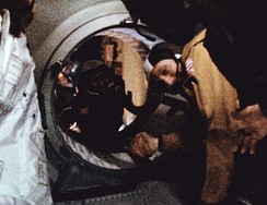 American Stafford and Russian Leonov shake hands in space aboard the Apollo–Soyuz docking adapter.