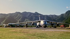 A Military Airlift Command C-141A at Pago Pago International Airport in July 1968. The aircraft behind the C-141 is an Air New Zealand DC-8.