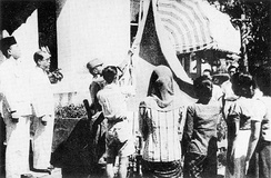 Bendera Pusaka, the first Indonesian flag, is raised on 17 August 1945.