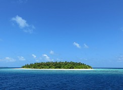 A typical desert island of Baa atoll, with its reef on the first ground.