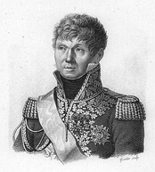 Black-and-white print labeled Victor shows a wavy-haired man with a small mouth. He wears a French military uniform of the Napoleonic era with elaborate braid on the front and high collar.