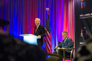 Lieberman speaks with former Republican Party presidential candidate and Governor of Utah Jon Huntsman Jr. at a bipartisan event hosted by the No Labels Foundation in 2016