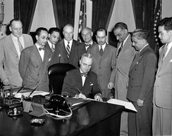 President Harry Truman signs the Luce–Celler Act of 1946, permitting Filipinos and Indians to naturalize and allowing a quota of 100 persons of each to immigrate annually.