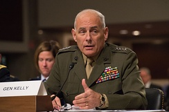 Kelly testifying before the Senate Armed Services Committee
