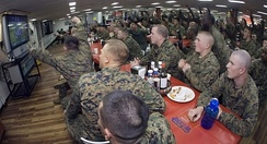Sailors and Marines aboard the USS Essex react as the Pittsburgh Steelers score against the Arizona Cardinals.
