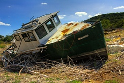 The 2011 Texas drought dried up many of central Texas' waterways. This boat was left to sit in the middle of what is normally a branch of Lake Travis, part of the Colorado River.