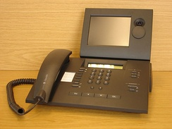 Deutsche Telekom T-View 100 ISDN-type videophone meant for home offices and small businesses, with a lens cover which can be rotated upward for privacy