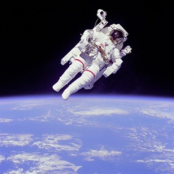 NASA Astronaut Bruce McCandless II using a Manned Maneuvering Unit outside Space Shuttle Challenger on shuttle mission STS-41-B in 1984.