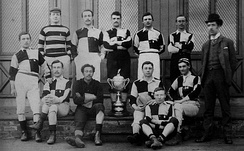 The 1887 team posing with the Cleveland Challenge Cup