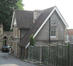 The privately owned cemetery has a gabled lodge house of 1885 at the entrance.