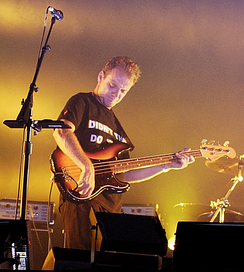 Guy Pratt, a professional session musician, playing bass guitar.