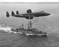 An Atlantic barrier WV-2 of VW-15 overflies USS Sellstrom off Newfoundland in 1957.