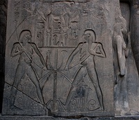 low relief within a sunk outline, linear sunk relief in the hieroglyphs, and high relief (right), from Luxor