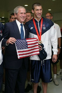 Swimmer Michael Phelps and then-President George W. Bush August 10, 2008 at the National Aquatic Center in Beijing. Phelps is the most decorated Olympic athlete of all time.[594][595]