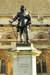 1899 statue of Oliver Cromwell, Westminster by Hamo Thornycroft outside the Palace of Westminster, London