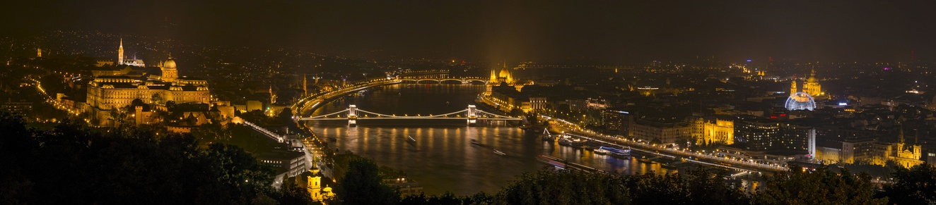 Night panorama of the Gellért Hill with the illuminated Buda Castle, Matthias Church, Danube Chain Bridge, Parliament, Hungarian Academy of Sciences, St. Stephen's Basilica, Budapest Eye and Vigadó Concert Hall