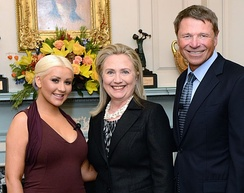 Aguilera (left) and Novak (right) were honored with the George McGovern Leadership Award in October 2012 for their contributions to the United Nations World Hunger Relief effort, while Clinton (center) was given a special tribute