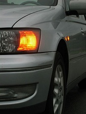 The blinking turn signal on motor vehicles is generated by a simple relaxation oscillator powering a relay.