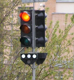 "Four-lamp public transport traffic light in Moscow, Russia, showing ""stop"" signal."