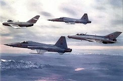 Two 64th Fighter Weapons Squadron F-5s with a 4477th TEF MiG-17 (leading) and MiG-21 (trailing) in 1979. Note the Tactical Air Command badge applied to the vertical fin of the MiG-21.