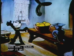 A still frame showing simulated closed captioning in the pop-on style
