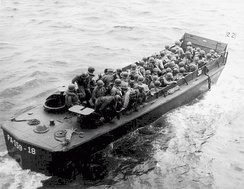 LCVPs, known as 'Higgins Boats', were the first specialized landing craft for the US Navy. Pictured, USS Darke (APA-159)'s LCVP 18, possibly with Army troops as reinforcements at Okinawa, 1945.