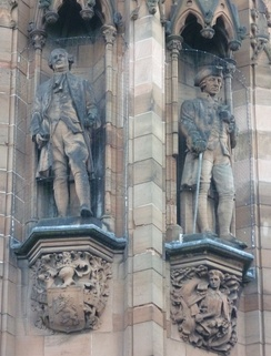 Statues of David Hume and Adam Smith by David Watson Stevenson on the Scottish National Portrait Gallery in Edinburgh