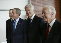 Carter (right), walks with, from left, George H. W. Bush, George W. Bush, and Bill Clinton during the dedication of the William J. Clinton Presidential Center and Park in Little Rock, Arkansas on November 18, 2004