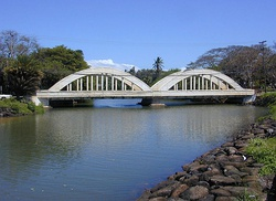 "Historic twin-span ""Rainbow Bridge"" over the Anahulu River marks the north end entrance to old Haleʻiwa Town"