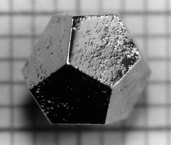 The material holmium–magnesium–zinc (Ho–Mg–Zn) forms quasicrystals, which can take on the macroscopic shape of a dodecahedron. (Only a quasicrystal, not a normal crystal, can take this shape.) The edges are 2 mm long.