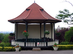 A bandstand is an example of a small outdoor venue. Bandstands are typically circular or semicircular structures that accommodate musical bands performing outdoor concerts, providing shelter from the weather for the musicians.