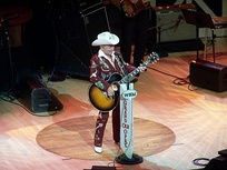 Little Jimmy Dickens, at the time the second-oldest living Opry member, at Opry House in 2004. The circle of wood is from the Ryman Auditorium's stage.