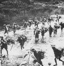 Infiltrators on the move in Laos down the Ho Chi Minh Trail.