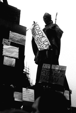 A statue of Saint Adalbert of Prague with a streamer and banners
