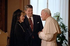 Pope John Paul II was credited as a major influence to the end of the Cold War and the fall of communism. Here with U.S. President Ronald Reagan and his wife, Nancy, in 1982.