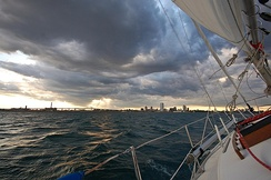 Milwaukee's skyline visible from a sailboat out on Lake Michigan