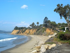 Westward view of Butterfly Beach and the coastal bluffs in Montecito