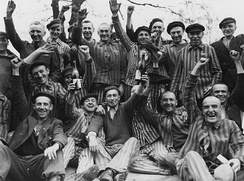 Polish prisoners toast their liberation from Dachau. Nazi persecution of Catholics was at its most severe in occupied Poland.