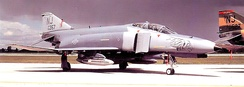 "141st TFS F-4E Phantom II 68-0357, about 1990. Note tail code ""NJ"" and Tiger illustration on nose"